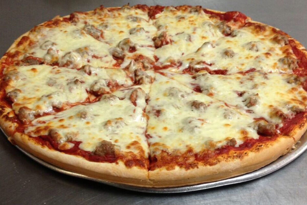 Photo of a thin pizza made by Nonno's pizza